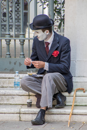 Venice, Italy - May 1, 2017: Mime rests on step