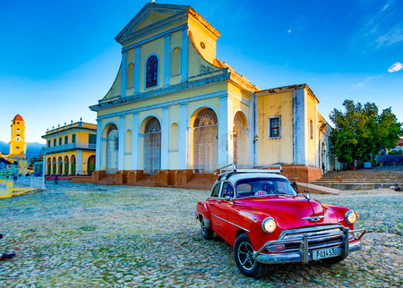 Trinidad, Cuba, Nov 28, 2017 - Red Classic 1950s Chevrolet is parked in front of a church Editorial