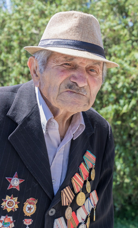 Yerevan, Armenia - June 14, 2017: 92 year old Armenian veteran of World War II had 124 medals, many of which he wore