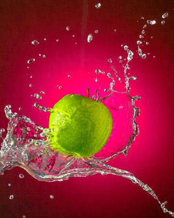 Water Splashes on Green Apple