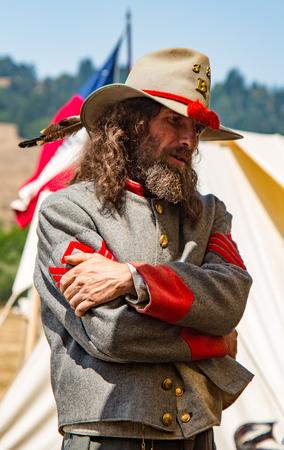 Duncan Mills, California - July 14, 2012: Man stands in Confederate uniform during Civil War Reenactment