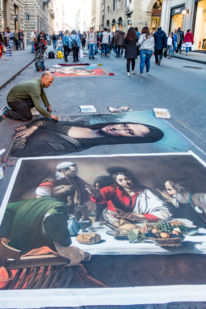 Florence, Italy - Apr 23, 2017: Man recreates famous paintings in chalk on the street Editorial