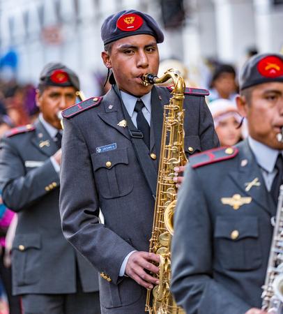 Cuenca, Equador - Dec 24, 2013: Military band plays during Paseo del Nino parade