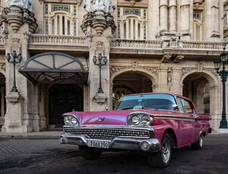 Havana, Cuba, Nov 21, 2017 - 1950's Classic American Red Ford Galaxie parked in front of Havana Opera House
