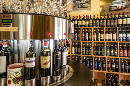Tuscany, Italy - May 5, 2017: Wine store has rows of wine, plus an automated tasting bar