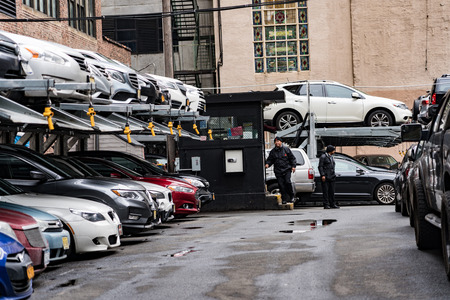New York, Feb 16, 2018 - Parking garage uses car elevators to pack more into space