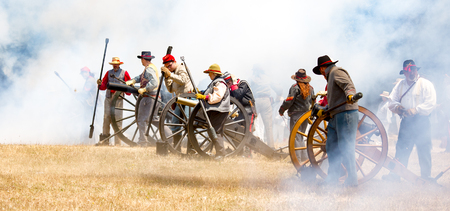Duncan Mills, California - July 14, 2012: Confederate soldiers fire canon during Civil War Reenactment Editorial