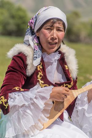 Almaty, Kazakhstan - June 3, 2017: Woman plays traditional string instrument