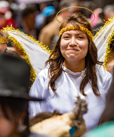 Cuenca, Ecuador - Dec 24, 2014: Woman dresses as angel in Paseo del Nino Parade Sajtókép