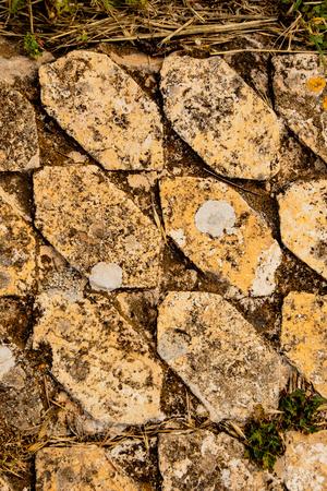 Background pattern from golden tiled floor