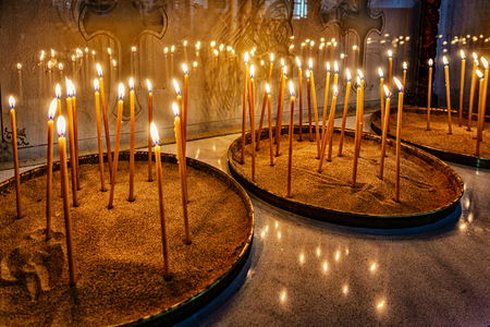 Prayer candles lit in Monastery of the Holy Cross in Cyprus Imagens