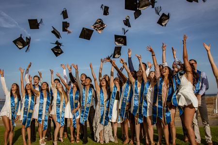SANTA BARBARBRA, CALIF, USA, JUNE 8, 2018 -  Graduating friends throw their graduation caps into the air