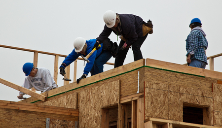 Oakland, Calif / Jan 8, 2011: Volunteers help to build new homes for the poor with Habitat For Humanity