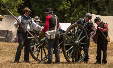 Duncan Mills, Calif / July 14, 2012: Men prime a canon during Civil War Reenactment
