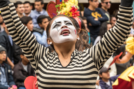 Ambato, Ecuador  Feb 15, 2015 - Mime performs for audience at Carnaval parade