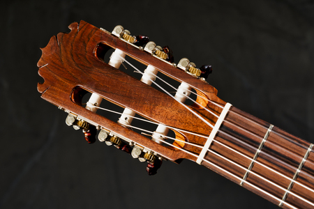 Closeup of an acoustic guitar frets, fretboard, tuners, headstock and truss rod Reklamní fotografie