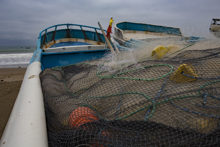 Fishing nets lay in boat, watiing to be used early the next morning in Puerto Lopez, Ecuador