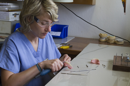 Guadalupe, Ecuador / May 27, 2014: Dental technician works on dentures for CinterAndes charity