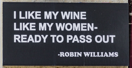 Tblisi, Georgia  June 8, 2017 - Sign says I like my wine like my women, ready to pass out