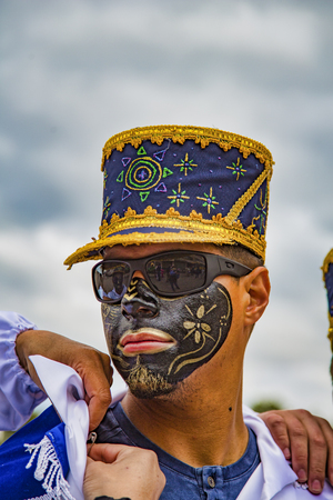 Latacunga, Ecuador - September 22, 2018 - Young men dress in decorated Black Face to celebrate African slave that saved the town in the 17th century