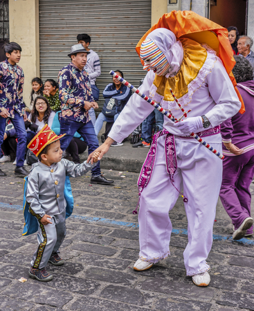 Latacunga, Ecuador - September 22, 2018 - A clown leads each neighborhood group in the Mama Negra parade, to announce his group Editorial