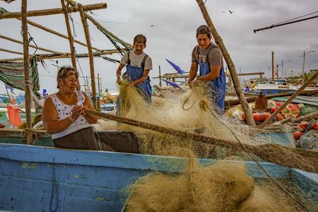 San Pedro, Ecuador - September 14, 2018 - fishing nets being repaired by fishermen Editöryel