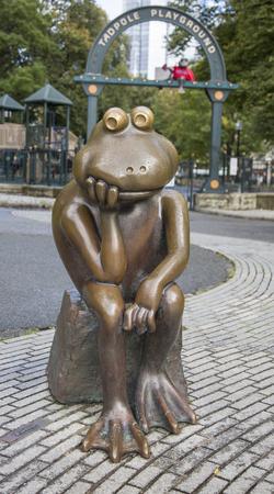 Boston, Massachusetts - October 25, 2018 - Bronze frog overlooks Tadpole Playground