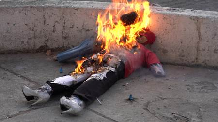 Cuenca, Ecuador - December 31, 2018 - Rockets fire inside effigy representing bad from the Old Year as it is burned on the street