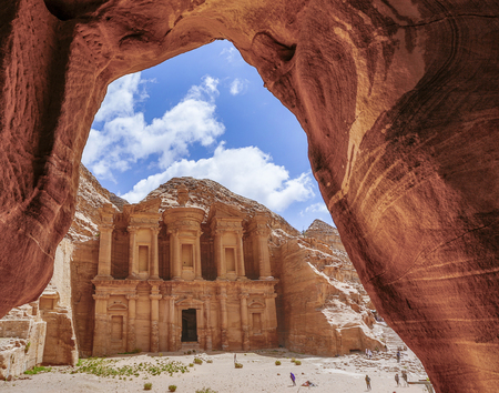 The Treasury through a cave opening at Petra Ruins in Jordan