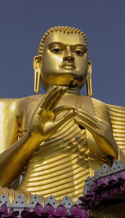Giant Golden Buddha Statue at Golden Temple of Dambulla in Sri Lanka.