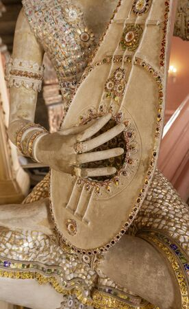 Statue of Imp God in Gangaramaya Temple in Colombo Sri Lanka - Playing Mandolin.