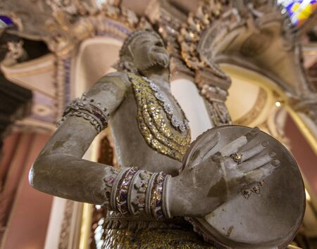 Statue of Imp God in Gangaramaya Temple in Colombo Sri Lanka - Playing Drum Low View. Archivio Fotografico - 125128109