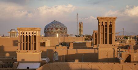 The skyline of Yazd Iran at sunset. Imagens