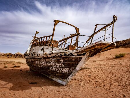 Strange Boat Stuck on Sand Hundres of KM From Nearest Water in Wadi Rum Jordan. 写真素材