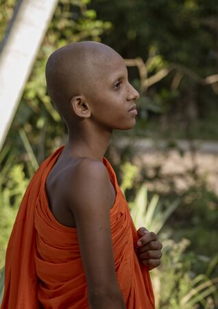 ED-Negombo, Sri Lanka - 2019-03-22 - Lone Young Monk Looks Off Into Distance.
