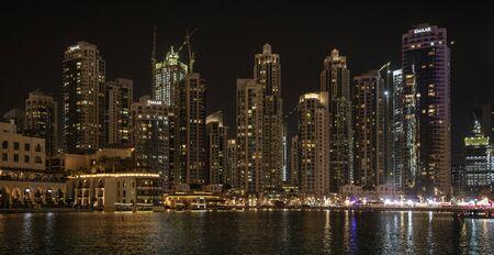 DUBAI, UAE, MAR 19, 2018: Skyscrapers line the marina in Dubai at night