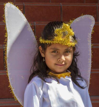 Girl dresses as angel for Christmas parade in Cuenca, Ecuador on Dec 24, 2013 Editorial