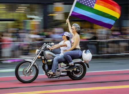 SAN FRANCISCO, CALIFORNIA, JUNE 24, 2018:  GAY PRIDE PARADE - Dykes On Bikes lead the parade past blurred audience 報道画像