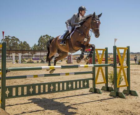 Petaluma, Calif - July 29, 2012: Woman jumps horse in steeplechase race
