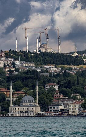 Construction cranes can be seen as mosque is being restored in Istanbul, Turkey Standard-Bild - 128584058