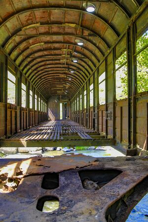 An old railroad car has been used as a bridge over a creek outside Kutasi, Georgia, but has now been left to crumble