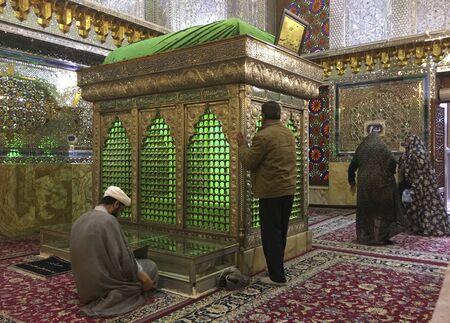 Shiraz, Iran - 2019-04-09 - Shah Ceragh Shrine - men pray at mirrored tomb of mullah.