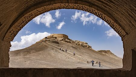 Yazd, Iran - 2019-04-11 - Stairs lead up to top of Tower of Silence where human sacrafice was once practiced as seen through arch.