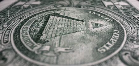 Eye of the pyrimid on the back of a United States dollar bill