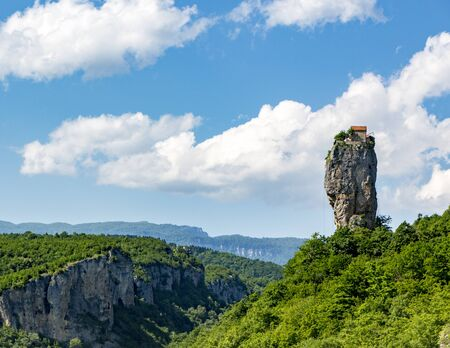 Katskhi Pillar is a single 120 foot tall towering pillar of rock with a small cell for a single monk at the top Imagens