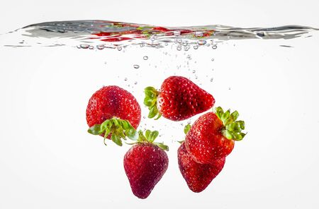 Ripe Strawberries Floating In Water after dropped