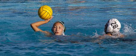 Water polo player prepares to throw ball in Cupertino, Calif match on Sept 22, 2011 에디토리얼