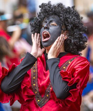 Cuenca, Ecuador - December 24, 2015 - Young men in Black Face costumes for Paseo de Nino parade 新闻类图片