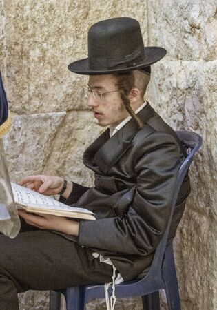 Jerusalem, Israel - 2019-04-26 - Young orthodox Jew studies holy book.