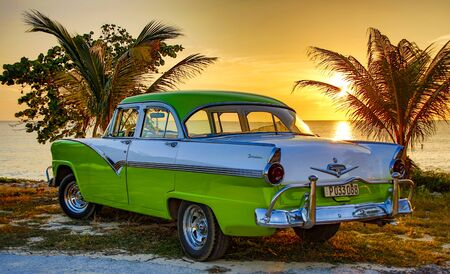 Trinidad, Cuba, Nov 28, 2017 - Green and white 1950 s Class America Ford Fairlane parked on beach Editorial